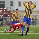 Kurt Smith of Romford reacts as a chance goes wide at Harlow (Gavin Ellis/TGSPHOTO)