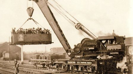 Local thrill-seekers go for a ride in an airborne freight car at Romford Station goods yard during t