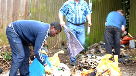 Left to right: Magnus Joseph, Guentels Enders and Michael Potts clean up rubbish