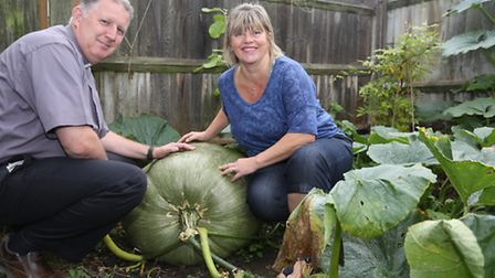 Ken and Eve Ashton with their pumpkin which they think is about 11 stone at their home in Hainault.