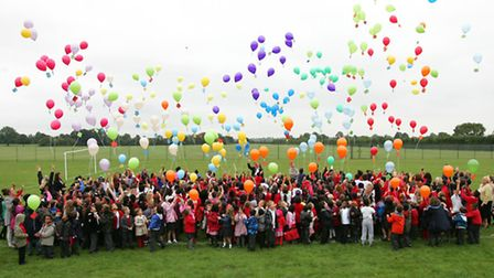 Children at John Bramston Primary School, are releasing hundreds of balloons with letters for people