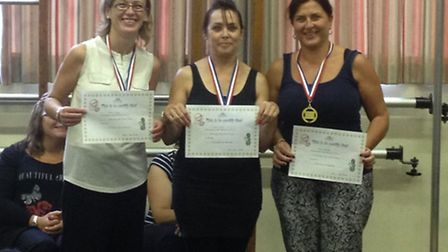 Teaching assistants Dita Gojnovc, Chris Sword and Sam Mustafa with their certificates for helping wi