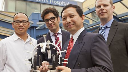 From left: Dr Davy Yeung, associate director of research and innovation; Mr Harith Akram, neurosurge