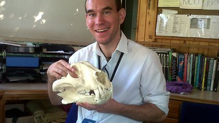 Jeff, at London Zoo, where he volunteers, holding a replica Bengal tiger skull