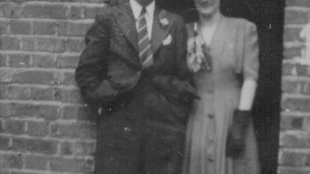 Violet Perkins and her husband, Bun, on their wedding day outside the house.