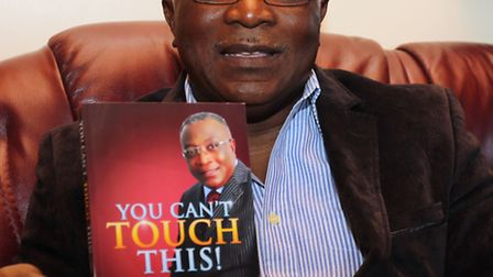 Bishop Kinsely Joshua Akoto-Bamfo with his book 'You can't touch this' at Powerland Chapel Internati