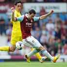 West Ham United's Matt Jarvis (right) holds off Cardiff's Peter Whittingham at Upton Park