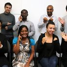 Members sign 'hello, empowering deaf society', from right to left. They will offer health and wellbe