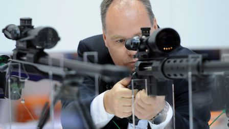 Thousands attend the arms fair where they can get hands-on experience of handling weapns