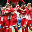 Orient players celebrate Kevin Lisbie's winner against MK Dons (Simon O'Connor)