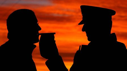 A motorist stopped by police taking a breath test. PRESS ASSOCIATION Photo credit John Giles/PA Wire
