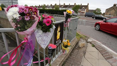 Flowers were left at the side of the road in tribute to Jothi Sriskandapalan, who was killed in an a