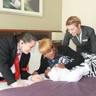 Security officer Michelle Long with Giselle Mbaki, baby Katea and hotel manager Gloria Taiariol.