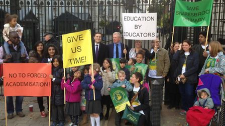 About 20 pupils and parents gathered outside the gates of Downing Street to hand in the petition