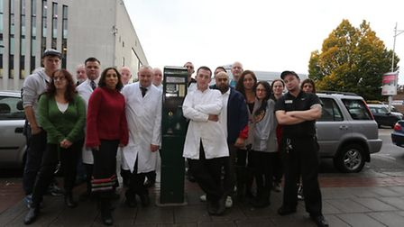 Businesses owners next to the broken parking machine in Barkingside High Street