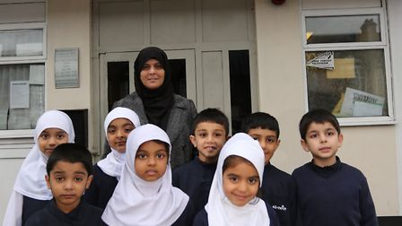 Headteacher Someera Butt with students outside Al Noor Primary School, in Green Lane, Goodmayes whic