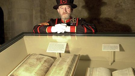 The chief yeoman warder Tom Sharp, at the Tower of London, with the Domesday book.