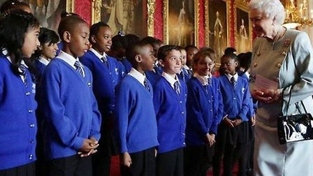 The choir from St Winefride's RC Primary met the Queen after a performance at Buckingham Palace Pic