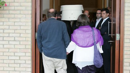 Grace's parents Karen and Peter enter the crematorium to say goodbye to their daughter.