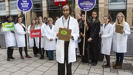 Shenan Perera with other Oxfam supporters outside Coca-Cola