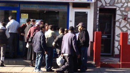Pilgrims outside Holy Makkah Tours office in Forest Gate