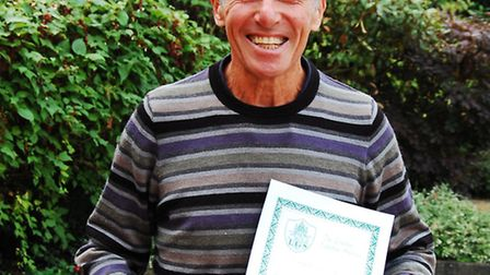Derek James, who has been volunteering at the hospice, is pictured with the award