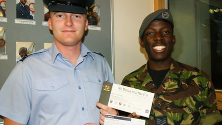 Mark Kawesa handed over the cheque to FLt Lt Chris Booty