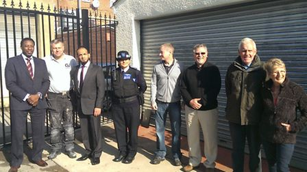 Residents, police and councillors by the new alleygate in Barkingside.