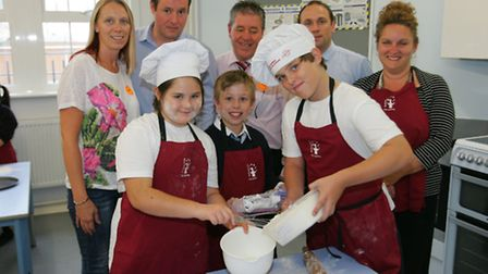 Maise Rowney, Jack Whale and Robert Dennis show the adults how to prepare food