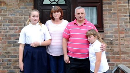 Left to right: Nicole, Judith, Dave and Lucy Butler in front of their house that they may be evicted