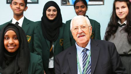 Holocaust survivor Bob Obuchowski with students from the Forest Academy