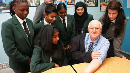 Holocaust survivor Bob Obuchowski with students from the Forest Academy. Bob still has the concentra