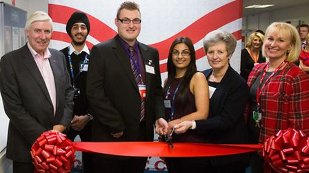 Luke Brook (centre) cutting the ribbon at Redbridge College's new Brook Centre with teachers and stu