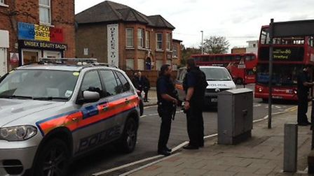 Armed police stopped a car in High Road, Ilford this afternoon