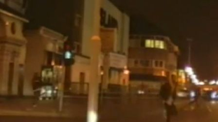 CCTV on a police car captured two men running away from the scene of the killing