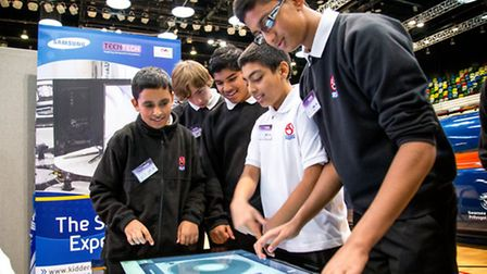 Pupils from the Eastlea Community School interact with a virtual mixing deck at the Samsung stand du