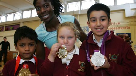 Olympic athlete Christine Ohurugu with Ashish, Alise and Steven from Roman road primary school
