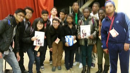 Young people from the Challenge Network donate �100 they raised for the appeal