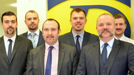 Staff at David Daniels Property Services with their Movember moustaches