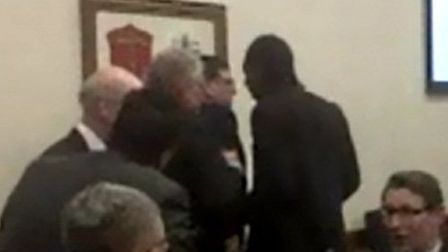 Footage taken in the town hall shows Cllr Jeffrey Tucker being restrained by the arms by Cllr Durant