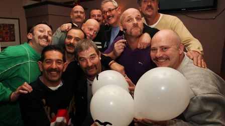 Men celebrate the end of Movember in a fundraising event at The Chequers Pub, Barkingside.