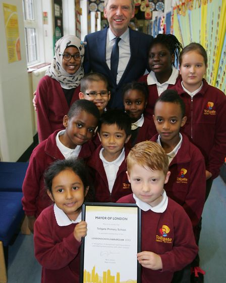 Tollgate primary head Tom Canning and pupils with the gold club award