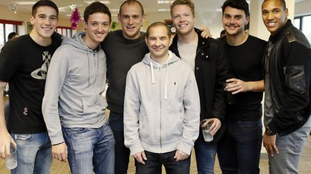 Orient players (and fan Stuart Minchin, centre) celebrate their Movember efforts. Simon O'Connor Pho