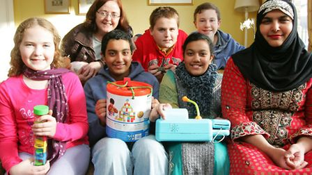Mary Busk and Asia Fazal, of Interface, with their children launch the toy appeal