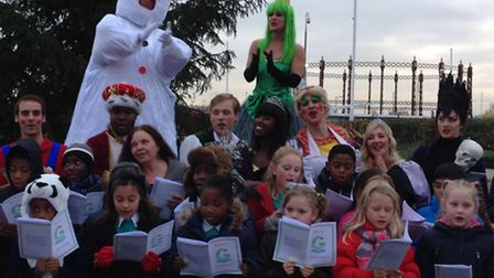 Broadway Theatre's panto cast with school children at Gallion�s Reach Shopping Centre, Beckton