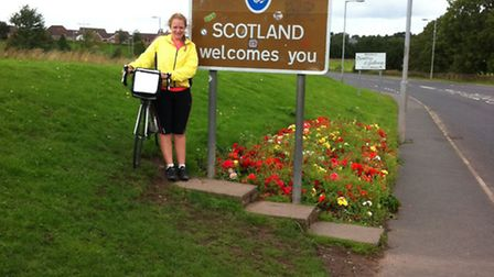 Emily poses at the Scottish border with the end in sight.