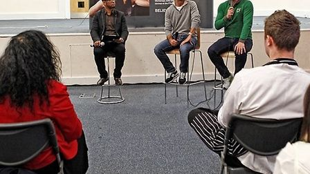 Students from Newham College listen to Ryan Giggs and Gary Neville talk about Cafe Football
