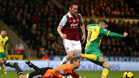 Jussi Jaaskelainen fouls Norwich City's Gary Hooper for the penalty