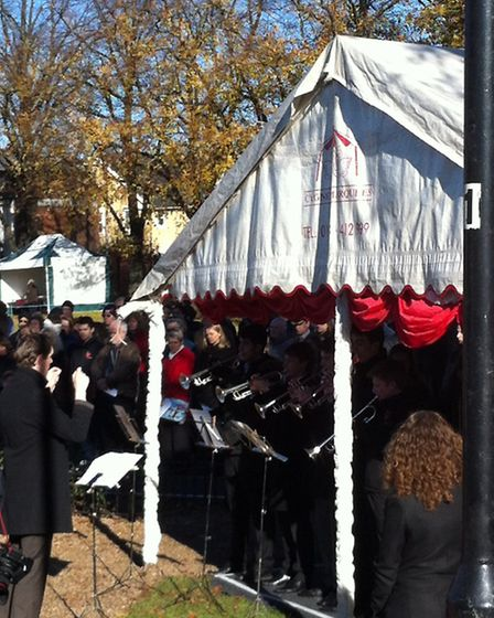 Musical director Chris Wilcox orchestrates Redbridge Music School's symphonic band as they play The