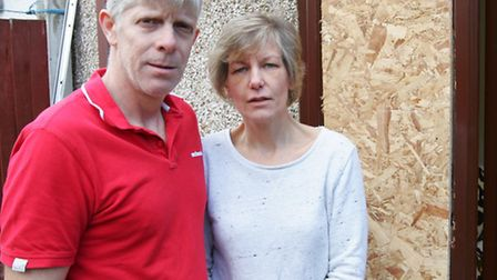 Colin and Jane Gregory outside their house after the break-in - the raid has left them 'jumpy'